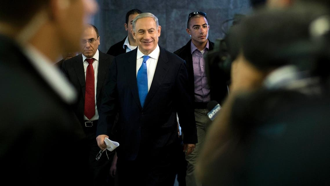 Israel's Prime Minister Benjamin Netanyahu (C) arrives to the weekly cabinet meeting in Jerusalem July 14, 2013. (Reuters)