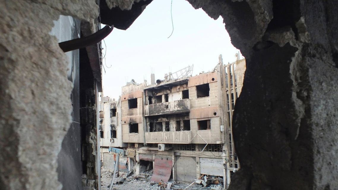 A view shows damaged buildings in the besieged area of Homs July 12, 2013.