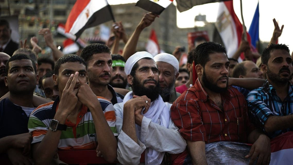 Muslim Brotherhood members and supporters of deposed president Mohammed Mursi take part in a rally outside Rabaa al-Adawiya mosque on July 15, 2013 in Cairo, Egypt. (AFP)