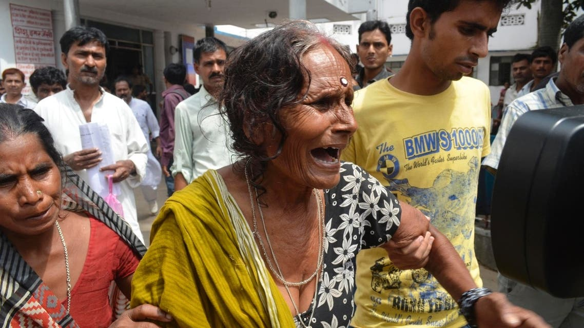 A woman cries after her grandson, who consumed spurious meals at a school on Tuesday, died at a hospital in the eastern Indian city of Patna July 17, 2013. (Reuters)