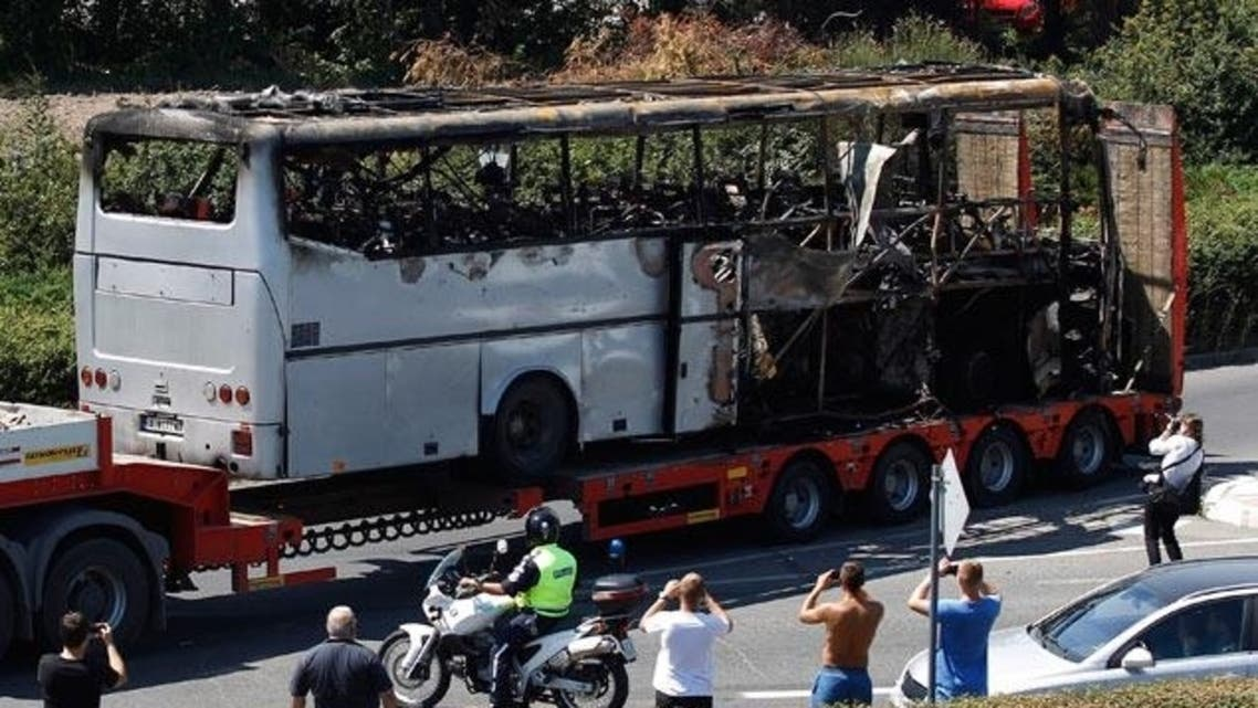 A truck carries the bus that was damaged in the bomb blast outside Burgas Airport, about 400km (248miles) east of Sofia July 19, 2012. (Reuters)
