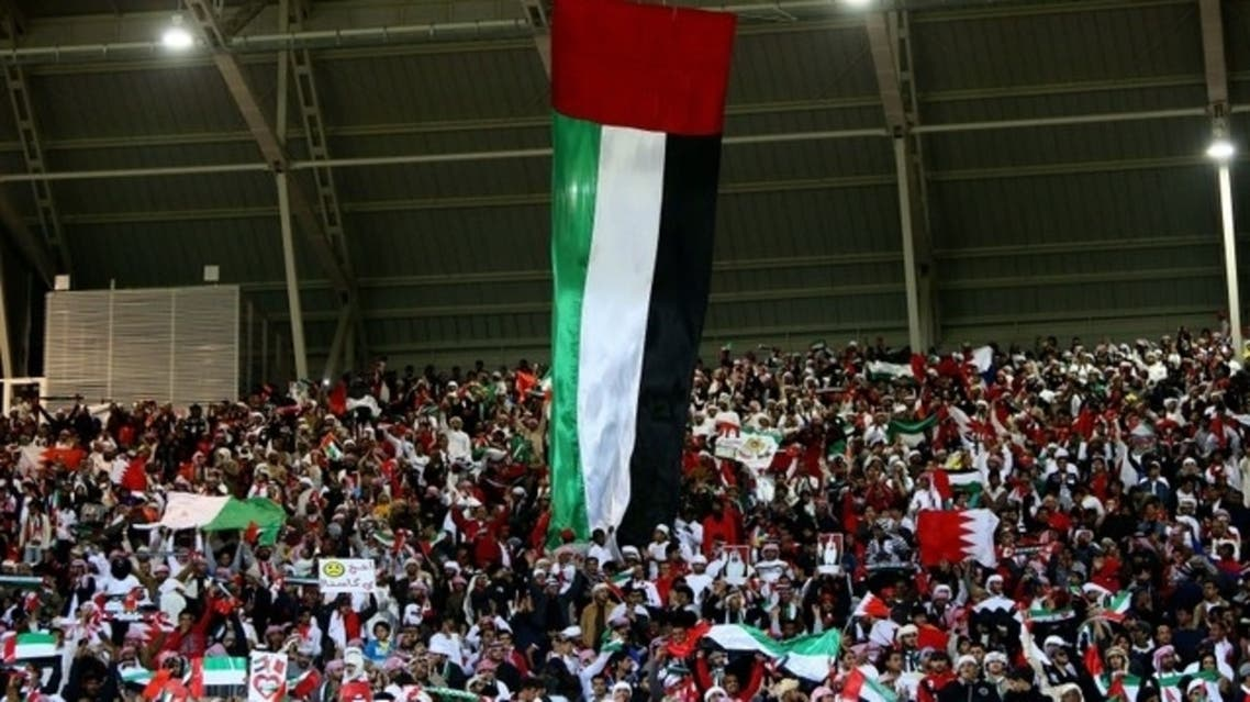 A UAE flag hangs over Emarati supporters as the UAE won the 2013 2013 Gulf Cup final. (File Photo: AFP)