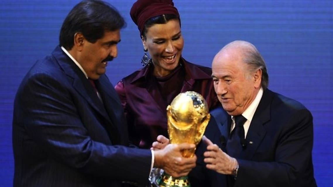 FIFA president Sepp Blatter hands over the World Cup trophy to the emir of Qatar Sheikh Hamad bin Khalifa al-Thani and his wife Chair in Zurich. (File Photo: AFP)