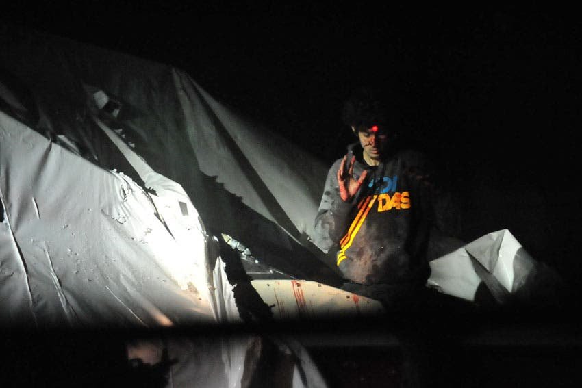 Tsarnaev appears leaving the boat right before he is captured by police officials. (Photo courtesy: Sean Murphy/Boston Magazine)