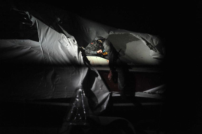 Tsarnaev is pictured near the boat where he was hiding. (Photo courtesy: Sean Murphy/Boston Magazine)