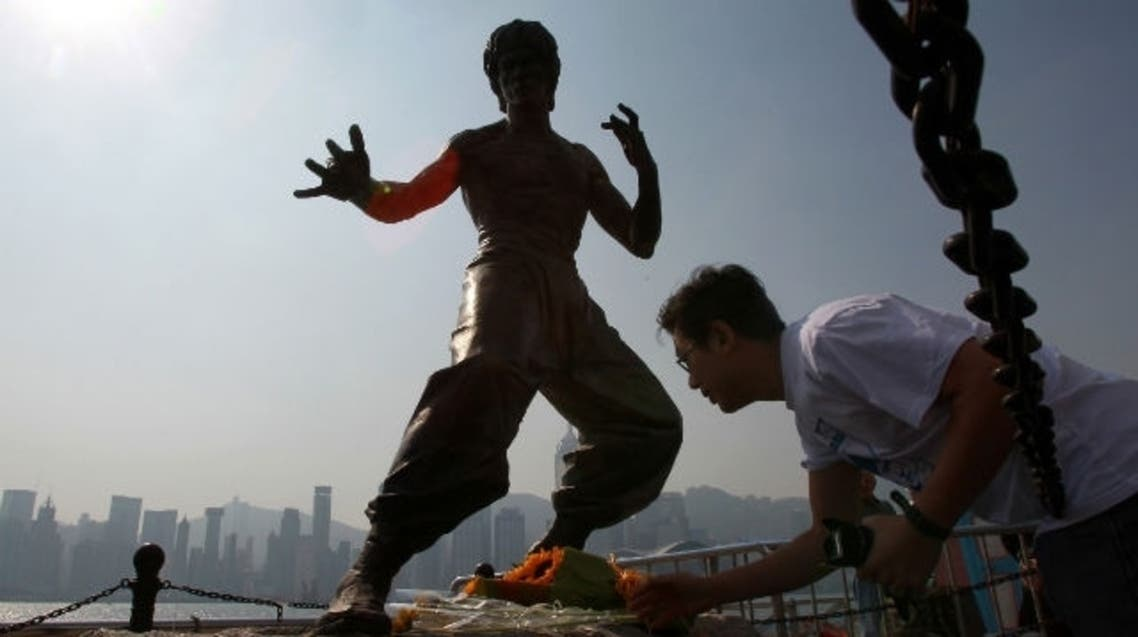 A sculpture of Bruce Lee at the Avenue of Stars is on the memorial trail dedicated to him.