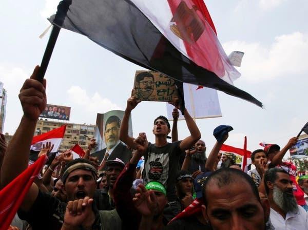 """العربية للدراسات: كيف سقطت """"أخونة"""" الدولة في عهد مرسي"""