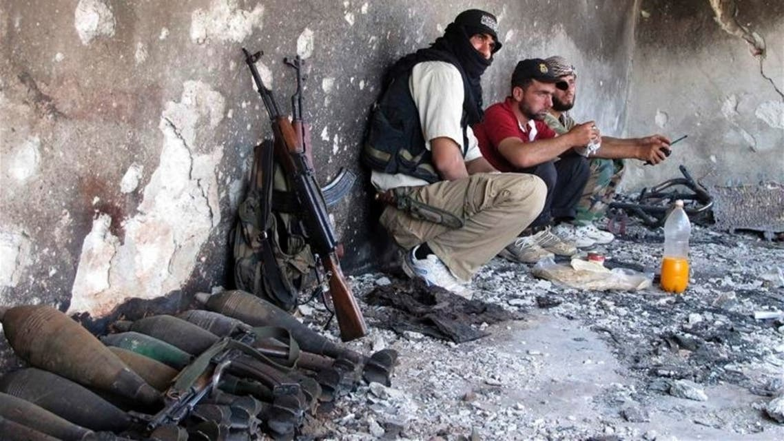 Free Syrian Army fighters take positions during what they say is an offensive against forces loyal to Syria's President Bashar al-Assad, in Idlib July 17, 2013.