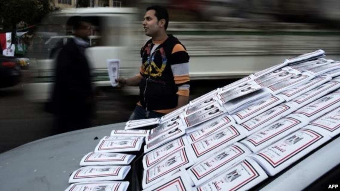 An Egyptian vendor puts on display drafts of the Egyptian constitution. (File photo: AFP)