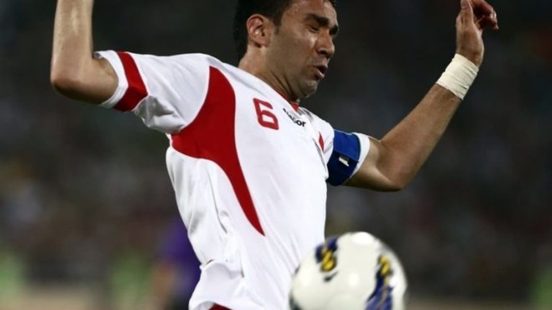 Iran's Javad Nekounam controls the ball during their 2014 World Cup qualifying match against Lebanon in Tehran, on June 11, 2013. Iran has barred Nekounam's lucrative transfer to a club in neighbouring UAE because of a dispute over a name, media reports said on Sunday. (File Photo:AFP)