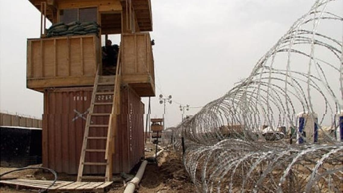 Security observation towers and barbed wire fencing at Abu Ghraib prison, west of Baghdad. (File photo: Reuters)