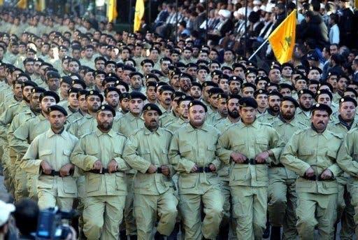 Hezbollah militants hold a rally in Baalbek, eastern Lebanon, on November 12, 2004 (AFP/File, Anwar Amro)