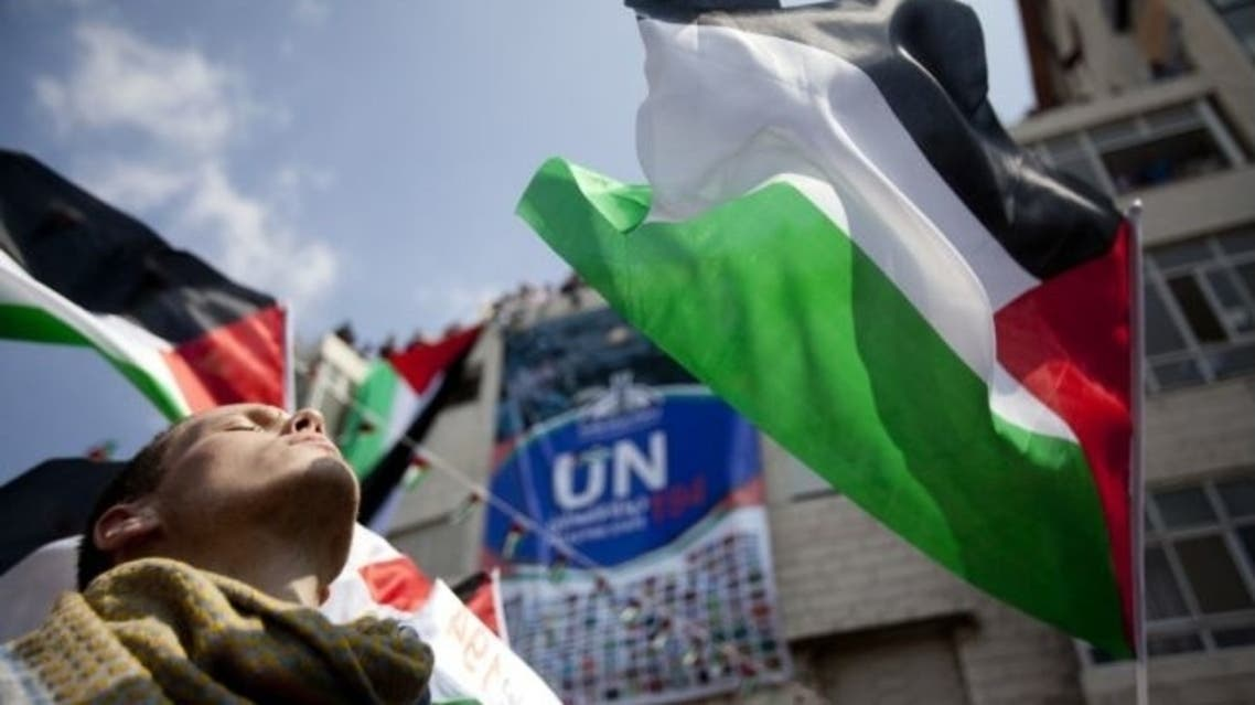 Palestinians attend a demonstration in support the Palestinian bid for recognition of statehood at the United Nations on Sept. 21, 2011 in Ramallah, West Bank.
