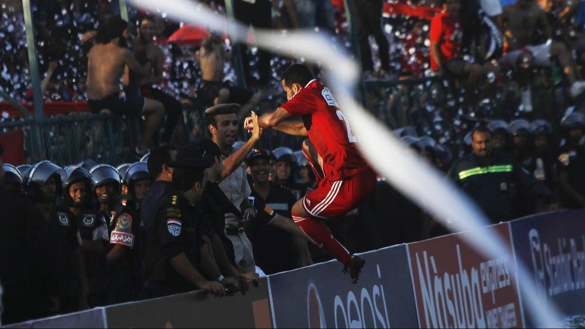 Al Ahly's Mohamed Abo Trika (C) celebrates with fans after scoring against derby rivals Zamalek during their CAF Champions League soccer match on July 24, 2013. (Reuters)