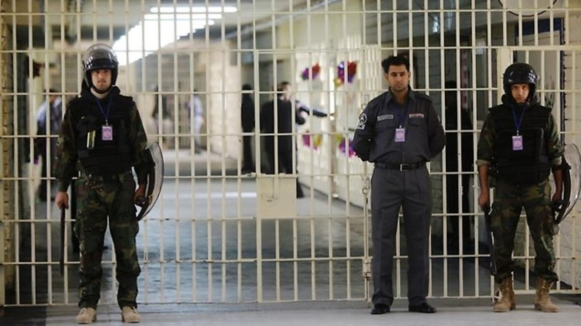 Guards stand at a cell block at the renovated Abu Ghraib prison in Baghdad, Iraq on Feb 21, 2009. (Photo courtesy: AP)