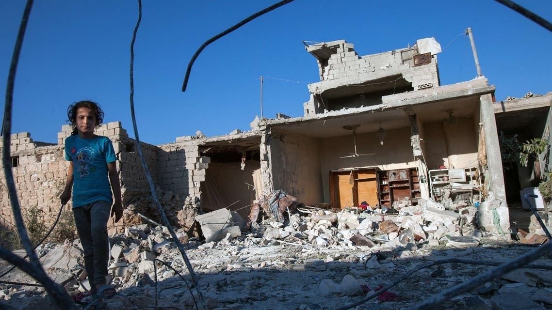 A Syrian girl walks next to the debris of her house in the northwestern Syrian province of Idlib, the same region Polish reporter Marcin Suder was abducted from. (File Photo: AFP)