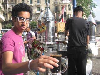 An Egyptian boy holding a cup of Erk soos. (Photo courtesy: rj310.blogspot.ae)