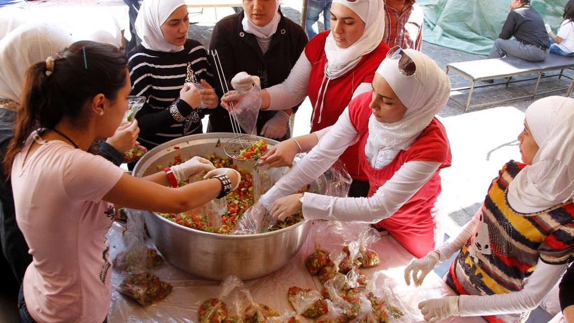 Syrian volunteers pack food for distribution to the poor and displaced during the Go Away Hunger charity campaign in the fasting month of Ramadan in old Damascus. (File Photo: Reuters)