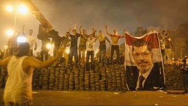 أنصار الإخوان يحشدون لمظاهرات مع بدء محاكمة مرسي