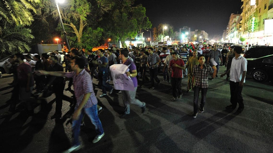 Protesters demonstrate against the killing of lawyer and prominent Libyan political activist Abdelsalam al-Mosmary on the streets of Benghazi, July 27, 2013.