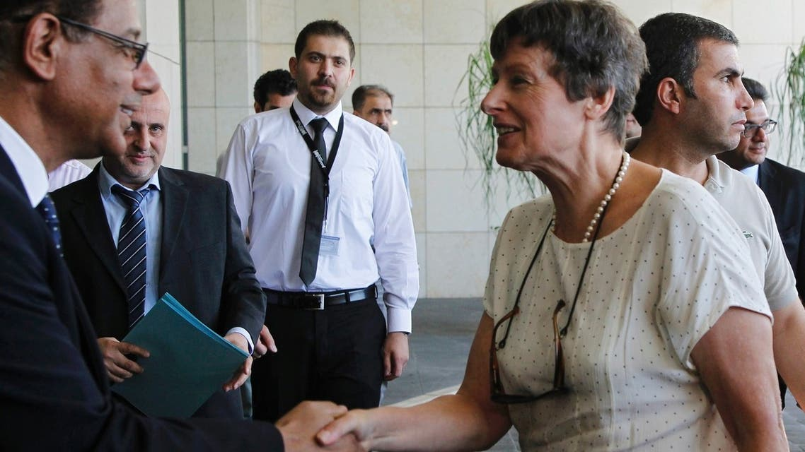 A U.N. employee welcomes Angela Kane (front R), head of the U.N. Office of Disarmament Affairs, as she arrives in Damascus July 24, 2013. Kane and Ake Sellstrom, head of a U.N. chemical weapons investigation team, arrived in Syria on Wednesday to discuss the later's inquiry into allegations that chemical arms have been used in Syria's civil war. Reuters