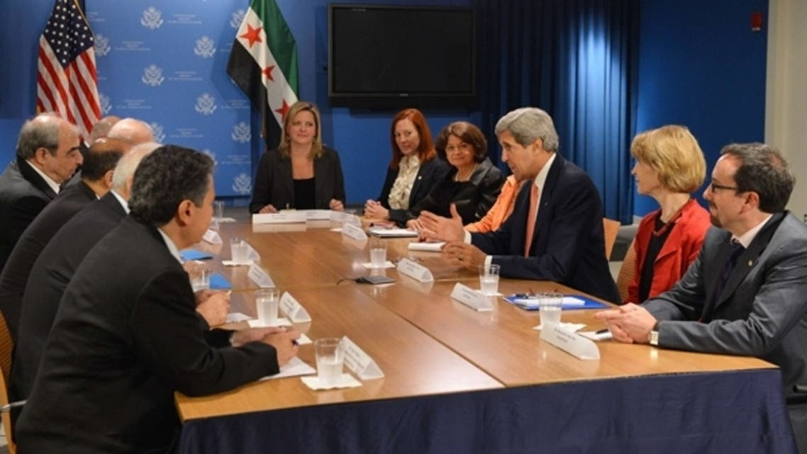 U.S. Secretary of State John Kerry (3rd R) meets with members of the Syrian Opposition Coalition (L) at the United States Mission to the United Nations July 25, 2013 in New York. (AFP)