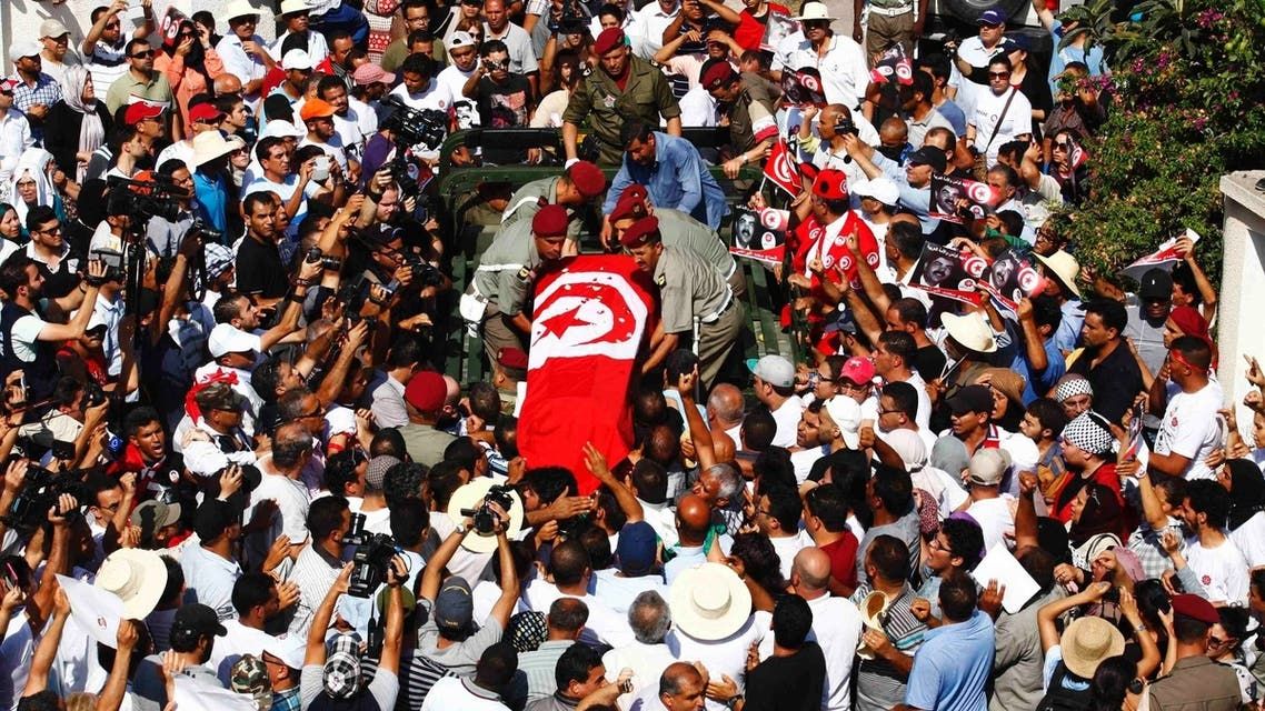 Mourners carry the coffin of slain opposition leader Mohamed Brahmi during his funeral procession towards the nearby cemetery of El-Jellaz, where he is to be buried, in Tunis July 27, 2013. (Reuters)
