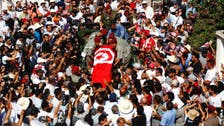 Thousands protest Tunisian government at opposition leader funeral