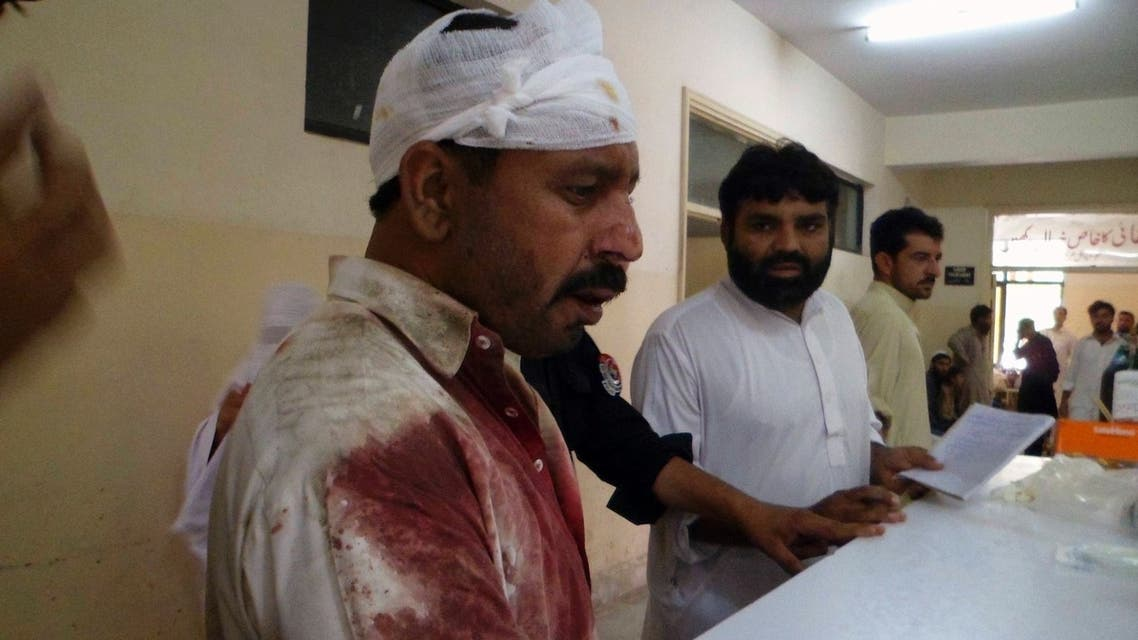 A man, who was injured in a blast, stands at a hospital in Parachinar July 26,2013.