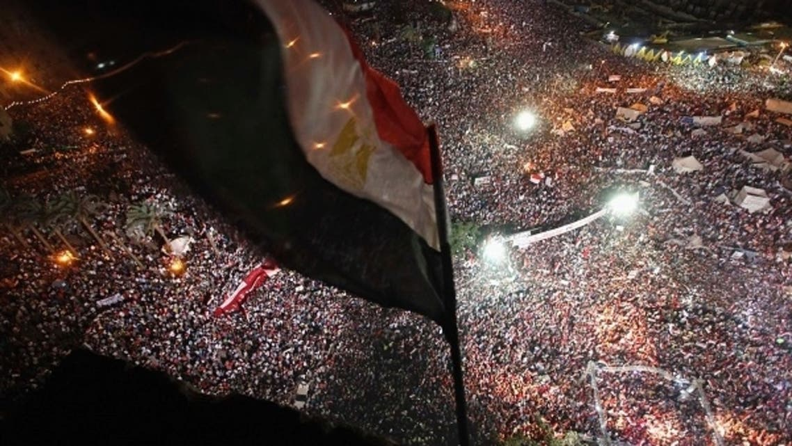 Anti-Mursi protesters chant slogans during a mass protest to support the army in Tahrir square in Cairo, July 26, 2013. (Reuters)