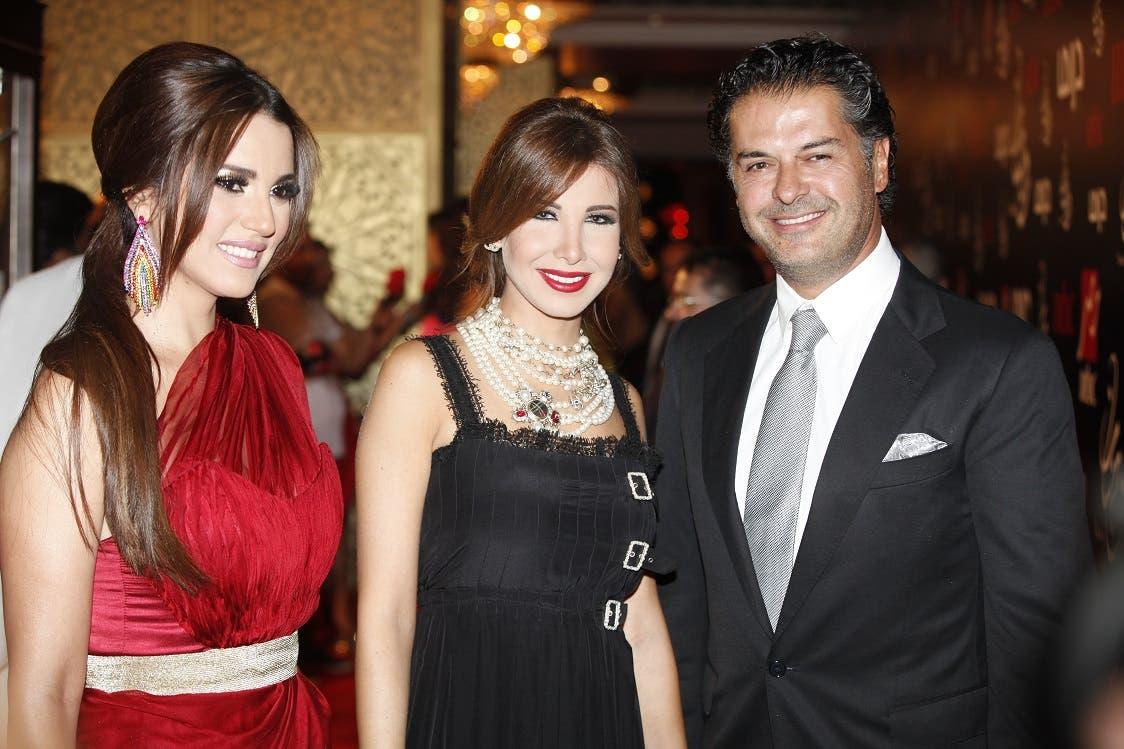 Dorra (L) with Nancy Ajram (C) and Ragheb Alame (R)