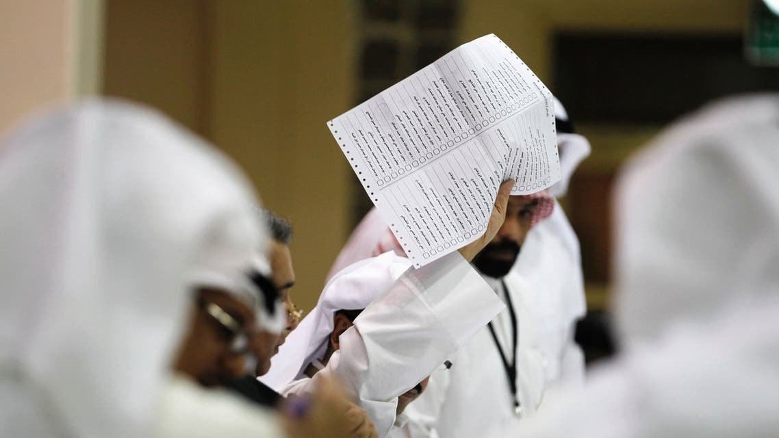 A judge counts votes during the early hours of the night after elections closed at the Khaldiya polling station in District 3, Kuwait City July 27, 2013.
