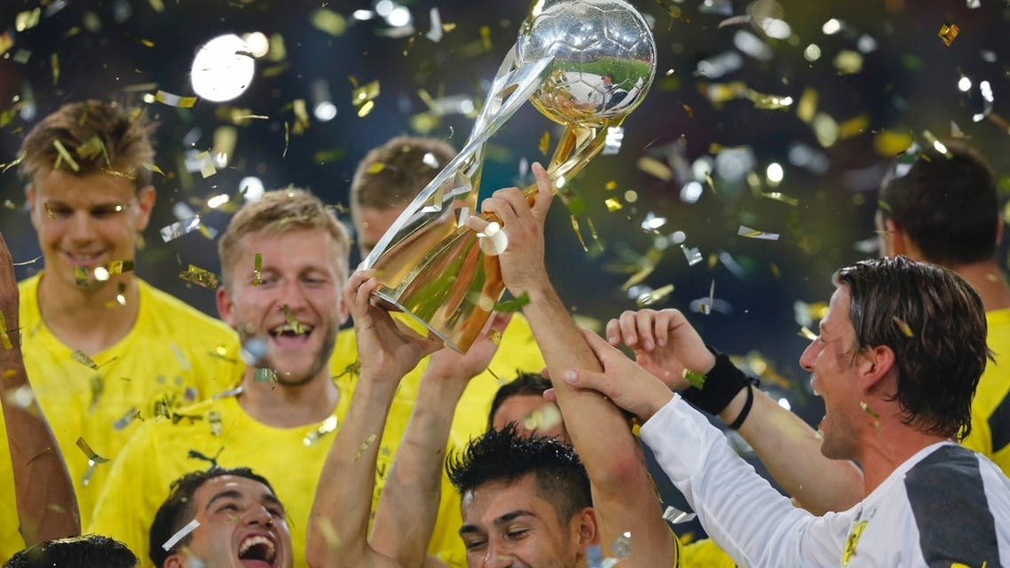 Borussia Dortmund's Ilkay Guendogan lifts the German Super Cup trophy after their 4-2 victory over Bayern Munich in their Super Cup 2013 soccer match in Dortmund July 27, 2013. (Reuters)
