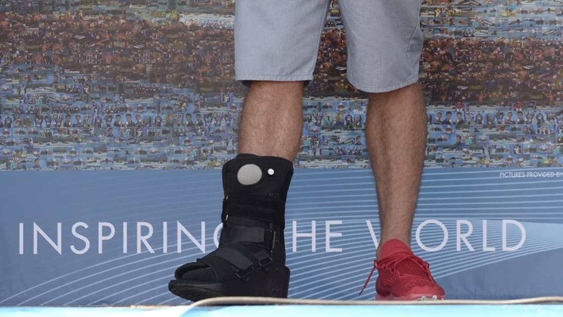American swimming gold-metalist Michael Phelps arrived at the Swimming Worlds in Barcelona with a fractured foot. (Photo courtesy: The Associated Press)