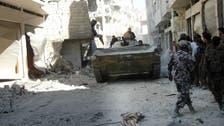 State TV: Syrian army retakes key Homs rebel district