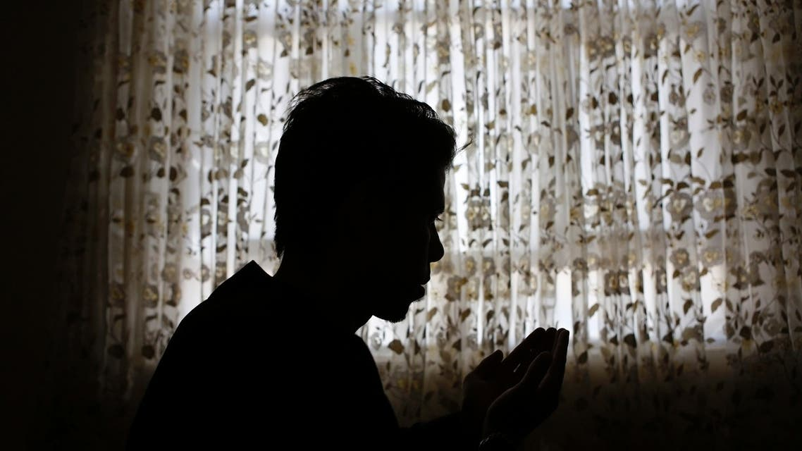 Naser Gulzad, 25, prays in his Kabul home July 25, 2013. (Reuters)
