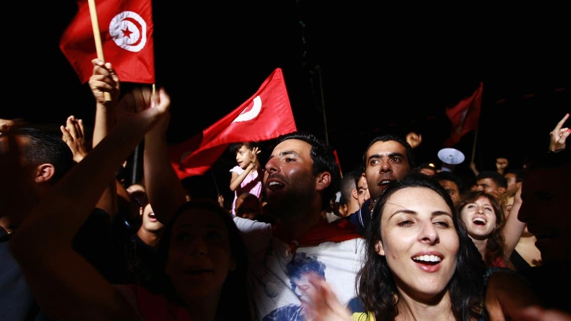 People waving Tunisian flags gather during a protest to demand the ouster of the Islamist-dominated government, outside the Constituent Assembly headquarters in Tunis July 29, 2013. (Reuters)