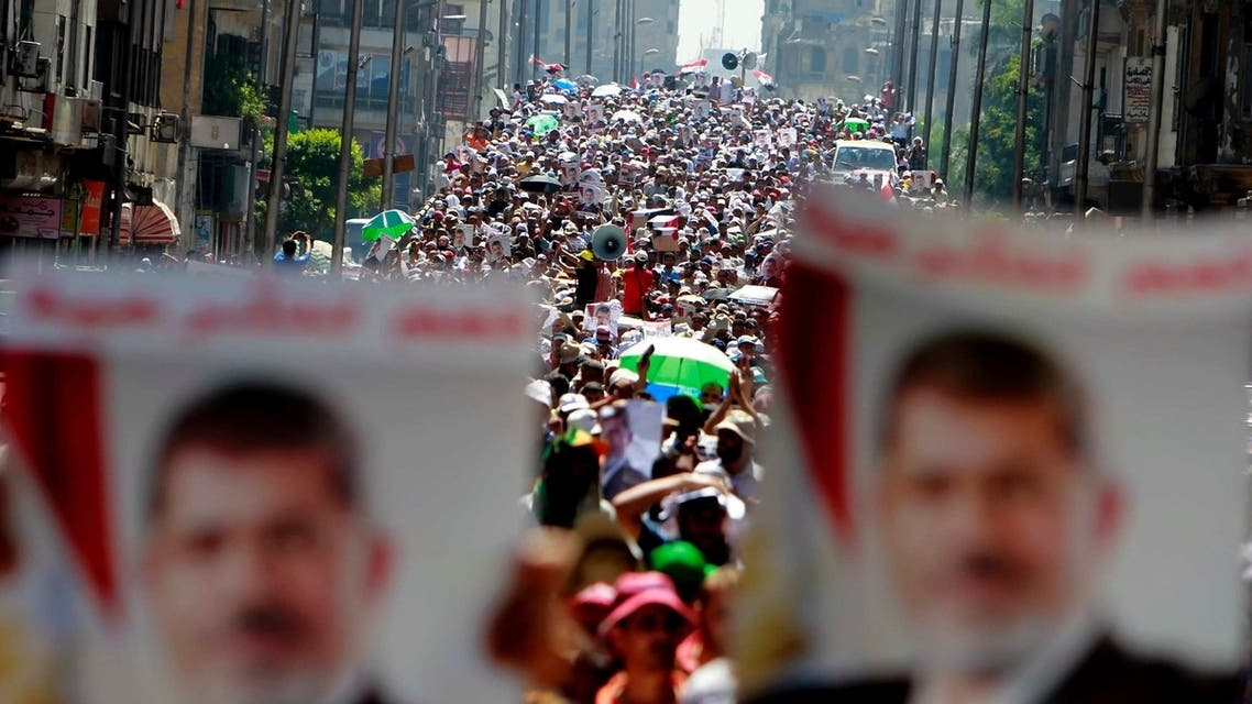 Supporters of deposed Egyptian President Mohamed Mursi shout slogans during a march from Al-Fath Mosque to the defence ministry, in Cairo July 30, 2013.