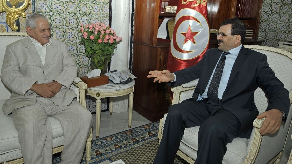 Tunisian PM Ali Larayedh (R) holds emergency meeting with Houcine Abbassi (L), Secretary General of the Tunisian General Labor Union (UGTT), in Tunis on August 1, 2013. (AFP)