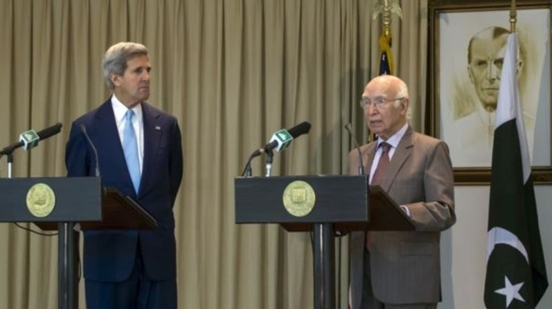 Kerry+Sartaj Aziz