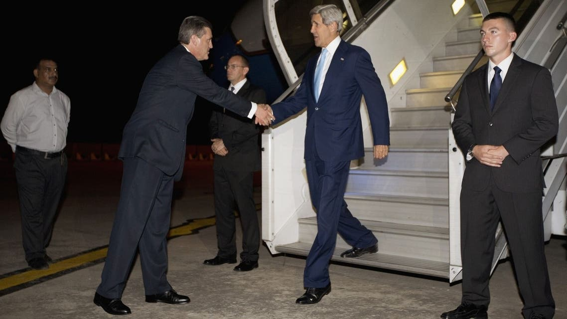 US Secretary of State John Kerry(R) is greeted by US Ambassador to Pakistan Richard Olson (2nd L) upon his arrival in Islamabad, Pakistan, July 31, 2013. (AFP)