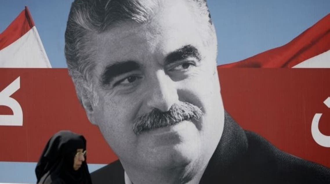 A Muslim woman walks past a portrait of slain Lebanese former premier Rafik Hariri displayed near his gravesite in central Beirut on August 19, 2011. AFP