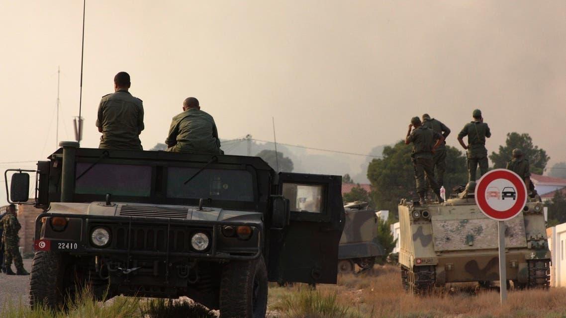 Tunisian soldiers gather near the border with Algeria around Mount Chaambi, western Tunisia August 2, 2013.