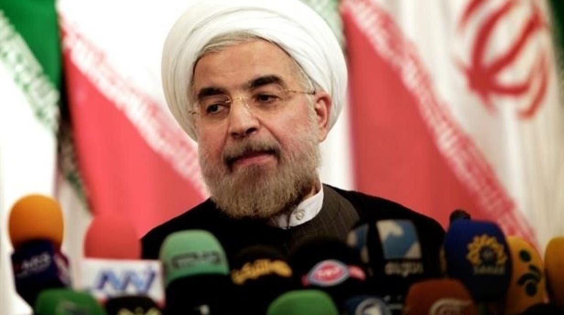 Iranian president-elect Hassan Rowhani listens to a question during a press conference in Tehran on June 17, 2013. (AFP)