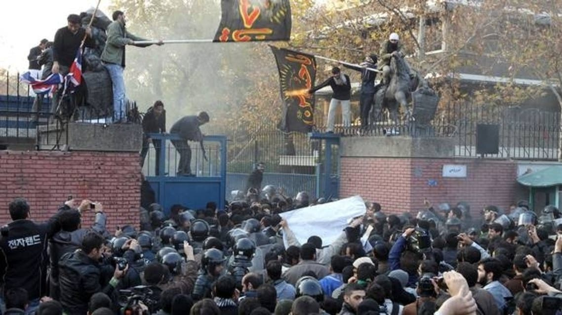 Iranian riot policemen try to prevent protesters from approaching the British embassy during a protest in Tehran on November 29, 2011. (File Photo: Reuters)