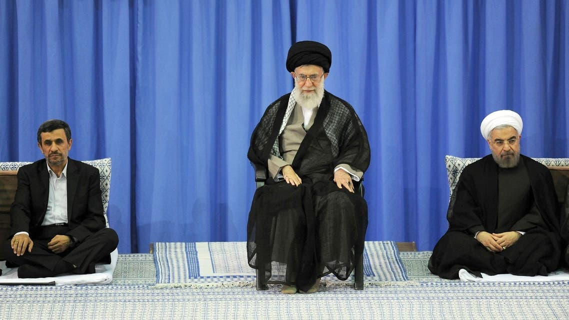 A handout picture released by the official website of the Iranian supreme leader Ayatollah Ali Khamenei on August 3, 2013, shows Khamenei (C) during a ceremony officially endorsing moderate cleric Hassan Rowhani (R) in the capital Tehran, as former president Mahmoud Ahmadinejad (L) sits by. AFP