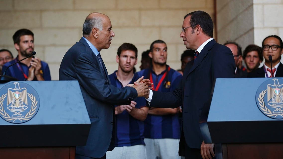 Barcelona President Sandro Rosell (R) and Palestinian Football Association President Jibril Rajoub shake hands after addressing members of the media at the start of a visit by the soccer team at the Palestinian President's office in the West Bank town of Bethlehem August 3, 2013. (Reuters)