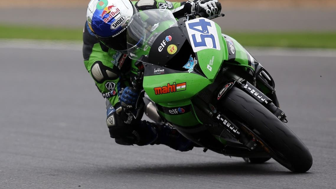 Turkey's Kenan Sofuoglu rides his Kawasaki ZX-6R during the Supersport race at Silverstone in Northamptonshire on August 4, 2013. (AFP)