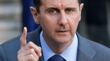 Syria limits foreign currency use, threatens traders with jail