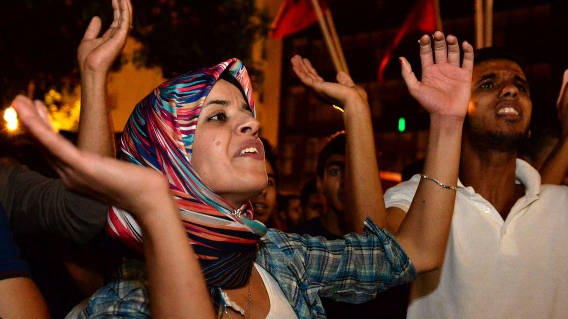 Moroccans protest against royal pardon